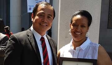 Business Counselor Steve Meng with Buna Ethiopian Market Owner Helena
